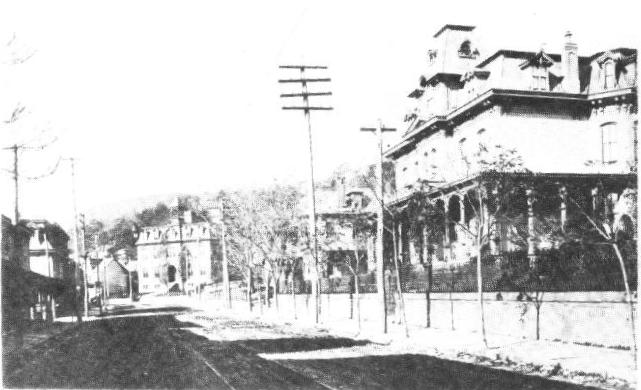 The Washington School can be seen in the background, at the end of turn-of-the-century Sunbury Street. The McConnell Mansion is also visible at the right.