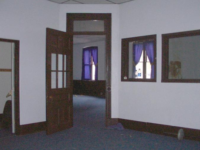 The center room of the first floor; showing door to large room. At left edge of photo is the doorway of the corridor from which I entered. I snapped this photo with the flash on; it was actually quite dim.